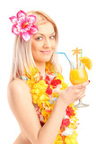 Smiling woman dressed in a traditional costume drinking cocktail