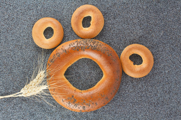 Large and small bagels, ear of wheat and poppy seed