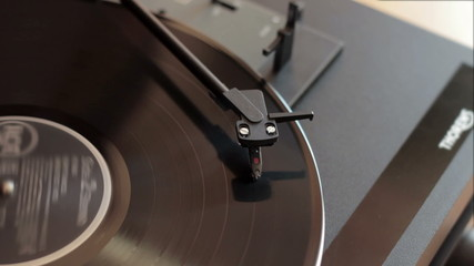 Record player with vinyl record, out of focus