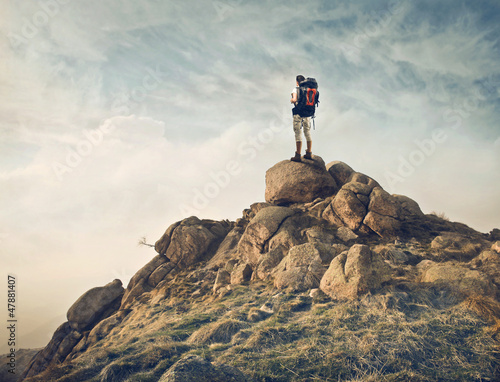 Traveler on a Rock