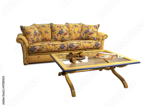 Antique and decrated sofa with coffee table isolated on white