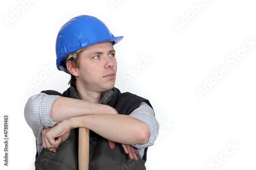 Worker resting on wooden stick