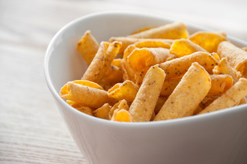 cheese potato chips in a white bowl