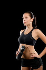Fit woman in black sportswear posing