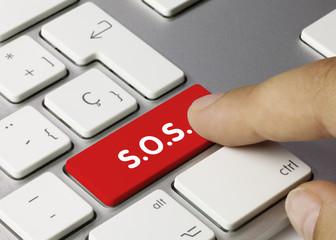 S.O.S. keyboard key. Finger