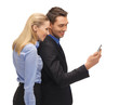 man and woman reading sms