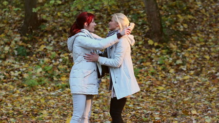 Two female friends meet in the park
