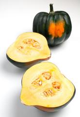 Acorn squash isolated whole and halves
