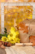 Autumnal composition with gift,flowers and leaves