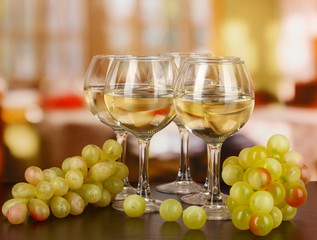 White wine in glass on room background