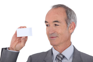 Man holding businesscard