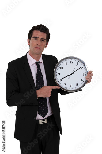 Man pointing at clock
