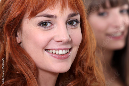 closeup portrait of young woman all smiles with ginger hair