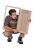 Carpenter with cabinet door
