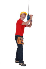 Tradesman adding an extension to his screw gun