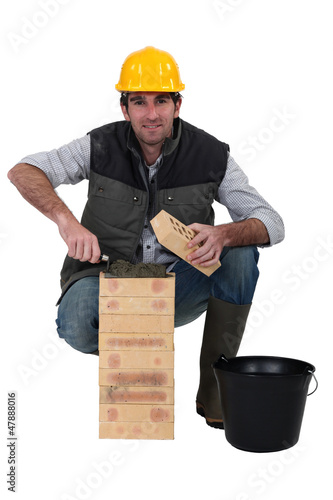portrait of bricklayer against studio background