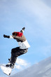 Man jumping with snowboard