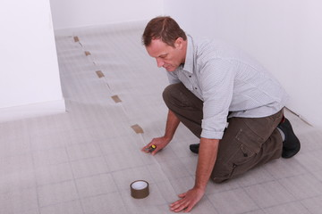 Man covering floor