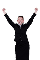 Young businesswoman raising arms in delight