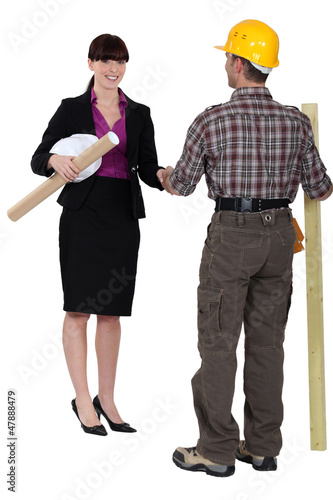 Female architect and male carpenter