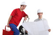 young electrician and foreman working hand in hand