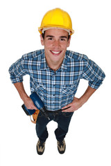 Young tradesman holding a power tool