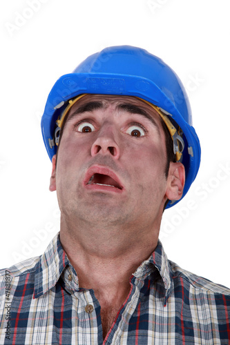 Horrified manual worker