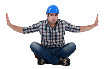 Builder sat on floor cross-legged