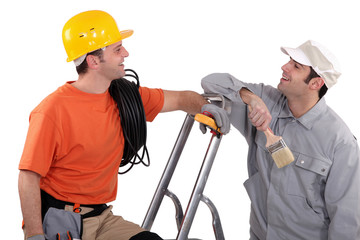 a house painter and an electrician laughing
