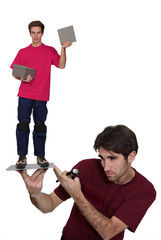 man in burgundy shirt carrying boy on flagstone