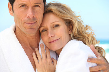 close-up of a couple in bathrobes