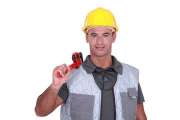Man resting wrench on shoulder