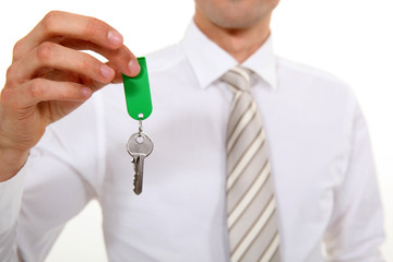 Businessman giving key