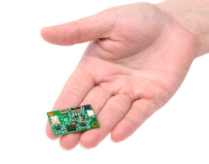 Miniature electronic circuit board on handground