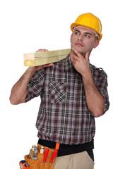 Carpenter carrying lumber