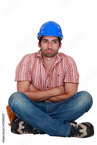 Laborer sitting with arms crossed