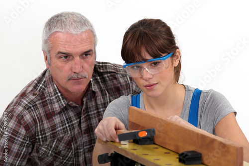 Experienced tradesman supervising his apprentice