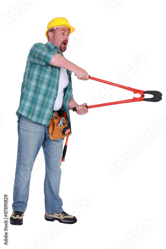 Shocked construction worker using a pair of boltcutters