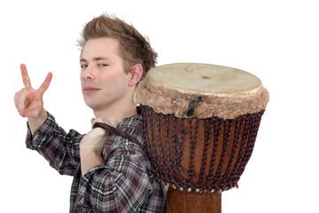 Man carrying bongo on back