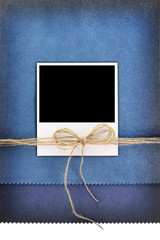 Polaroid photo frame on vintage blue background
