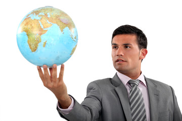 Ambitious businessman with globe in hand