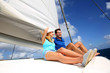 Cheerful couple cruising on a catamaran in Caribbean sea