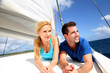 Smiling couple relaxing on a yacht by sunny day