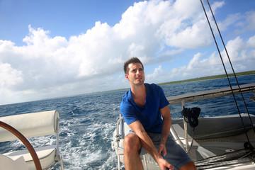 Sailot pulling on sail rope during navigation