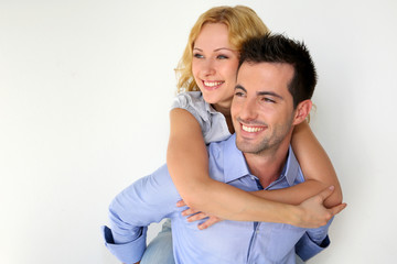 Man carrying girlfriend on his back