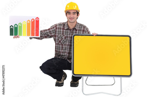 Tradesman with a traffic sign and holding an energy rating