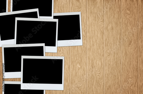 photo frame on wood plank background with clipping path