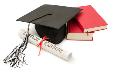 Stack of books with cap and diploma
