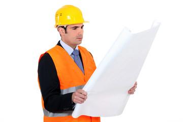 Architect reading plans