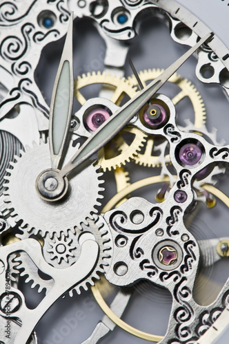 Leinwanddruck Bild close view of watch hands and mechanism